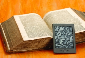 Image of an open book and a tablet device